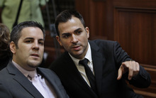 Plaintiff same sex couple Jeffrey Zarrillo, left, and partner Paul Katami listen in a courtroom during a California State Supreme Court hearing in San Francisco on Tuesday, Sept. 6, 2011. On Tuesday, the California Supreme Court will be considering whether the sponsors of Proposition 8 have a legal right to appeal the federal court ruling that overturned the same-sex marriage ban, since the governor and attorney general refused to bring such an appeal. The 9th US District Court of Appeals, which has main responsibility for the case on appeal, asked the state court to weigh in on the question it deals with the state's ballot initiative process. (AP Photo/Paul Sakuma)