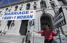 Natalya Choban of Sacramento, Calif., protests against gay marriage outside a courtroom where the California Supreme Court was hearing arguments in San Francisco on Tuesday, Sept. 6, 2011. Although the legal challenge to California's same-sex marriage ban always has been assumed to be on track to reach the U.S. Supreme Court, the state's highest court is contemplating an issue that could halt the high-profile case in its tracks. (AP Photo/Eric Risberg)