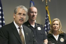 FBi Special Agent  James McTighe  (left)  police chief Chris Burbank and district attorney Lohra Miller joined  acting US Attorney for the state of Utah, Carlie Christensen, and  other law enforcement officials to announce grand jury indictments charging members of the Tongan Crip Gang  under federal RICO laws. Wednesday, May 12,2010  photo: