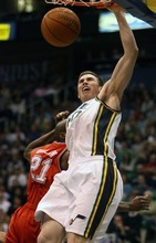 Steve Griffin  |  The Salt Lake Tribune   Utah's Gordon Hayward throws down a dunk over New Jersey Nets forward, Travis Outlaw, during second half action of the Utah Jazz versus New Jersey Nets basketball game at EnergySolutions Arena in Salt Lake City Wednesday, November 17, 2010.