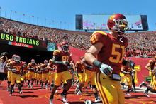 September 3, 2011 Los Angeles, CA..The USC Trojans football team run out of the tunnel prior to the NCAA Football game between the USC Trojans and the Minnesota Golden Gophers at the Los Angeles Memorial Coliseum in Los Angeles, California. USC defeated Minnesota, 19-17..Josh Thompson/CSM. (Cal Sports Media via AP Images)