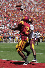 Southern California wide receiver Robert Woods, left, catches a touchdown pass as Minnesota defensive back Kim Royston defends during the first half of their NCAA college football game, Saturday, Sept. 3, 2011, in Los Angeles. Woods caught a school-record 17 passes for 177 yards and three touchdowns, and No. 25 Southern California hung on to win 19-17. (AP Photo/Mark J. Terrill)