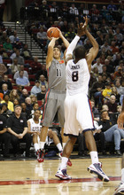 Junior National Select Team's Terrence Jones defends against World Select Team's Enes Kanter (11), of Turkey, in the first quarter during the Nike Hoop Summit Saturday, April 10, 2010, in in Portland, Ore. (AP Photo/Rick Bowmer)