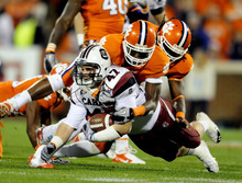 Richard Shiro  |  AP file photo South Carolina and Clemson continue to have a heated football rivalry despite the fact that the Gamecocks play in the Southeastern Conference and the Tigers are in the Atlantic Coast Conference.