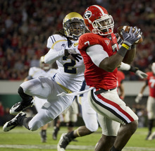 Rich Addicks  |  Associated Press file photo Georgia tight end Orson Charles pulls down a catch over Georgia Tech cornerback Mario Butler during the first half of an NCAA college football game in Athens, Ga., last year. Georgia trimphed in the Clean Old-Fashioned Hate match.