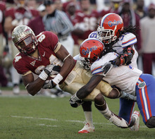 Steve Cannon  |  AP file photo Florida State's Rodney Smith is tackled by Florida's Will Hill and Moses Jenkins, right, after making a reception in the second quarter of an NCAA college football game Nov. 27, 2010, in Tallahassee, Fla. Florida State and Florida have split their past 37 meetings 18-18-1.