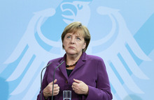 German Chancellor Angela Merkel gestures during a joint news conference with the Prime Minister of Finland, Jyrki Katainen, after a meeting at the chancellery in Berlin, Germany, Tuesday, Sept. 13, 2011. German Chancellor Angela Merkel on Tuesday sought to calm market fears that Greece is heading for a chaotic default on its debts as Europe struggles to contain a crippling financial crisis. (AP Photo/Michael Sohn)