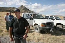Steve Griffin  |  The Salt Lake Tribune  West Valley City police Lt. Bill Merritt and other police officials pack up following a day of searching for the body of Susan Powell at the base of Topaz Mountain, background, near Delta , Utah Tuesday, September 13, 2011.