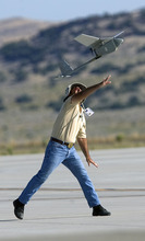 Al Hartmann  |  The Salt Lake Tribune Aircraft of the Unmanned System Integration Capability (MUSIC) was demonstrated at Dugway Proving Grounds on Thursday, Sept. 15.   Michael Reagan of AeraVironment launches a Raven, a small surveillance plane used in the demonstration.