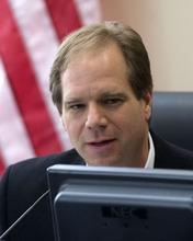 Al Hartmann   |  Tribune File Photo Utah tea party leader Dave Kirkham is considering running against Gov. Gary Herbert. He hasn't given up his consideration of instead challenging Sen. Orrin Hatch.