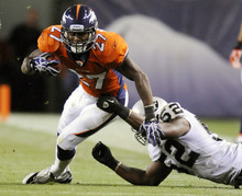 FILE - In this Sept. 12, 2011, file photo, Denver Broncos running back Knowshon Moreno (27) runs with pressure from Oakland Raiders linebacker Quentin Groves during an NFL football game, in Denver. The bruised and battered Broncos practiced Wednesday, Sept. 14, 2011, without a half-dozen key players, including Moreno, who were hurt Monday night against Oakland. (AP Photo/Jack Dempsey, File)