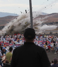 A P-51 Mustang airplane crashes into the edge of the grandstands at the Reno Air show on Friday, Sept. 16, 2011 in Reno Nevada. The World War II-era fighter plane flown by a veteran Hollywood stunt pilot Jimmy Leeward plunged Friday into the edge of the grandstands during the popular air race creating a horrific scene strewn with smoking debris. (AP Photo/Ward Howes)