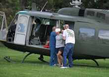 Medics help injured bystanders out of a helicopter into Renown Medical Center after a plane crashed into the crowd at the Reno National Championship Air Races Friday, Sept. 16, 2011 in Reno, Nev. A World War II era fighter plane plunged into the grandstands Friday during a popular annual air show, injuring at least 75 spectators and leaving a horrific scene of bodies and wreckage. (AP Photo/The Reno Gazette-Journal, Liz Margerum)  NEVADA APPEAL OUT;  NO SALES