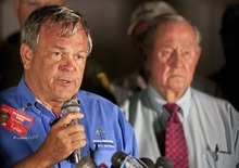 Mike Houghton, president of the Reno Air Racing Association, left, holds a news conference after a vintage World War II-era fighter plane plunged into the grandstands during a popular annual air show, killing at least three people, injuring more than 50 spectators at the Reno Air Races in Stead, Nev., on Friday, Sept. 16, 2011. (AP Photo/Kevin Clifford)