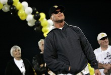 Djamila Grossman  |  The Salt Lake Tribune  Roy High School plays Box Elder High School at Roy, Utah, on Friday, Sept. 16, 2011. Former Roy football player Jim McMahon looks at the crowd before a speech, as his number was being retired during half time. McMahon went on to play in the NFL.