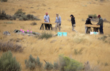 Investigators screen soil from a hole excavated by law enforcement where search dogs indicated the smell of human tissue decomposition near the base of Topaz Mountain as law enforcement looks for missing Utah mother Susan Powell, on Saturday, Sept. 17, 2011, 50 miles northwest of Delta, Utah. Powell disappeared from her West Valley City home in December 2009 and hasn't been seen since. (AP Photo/Jim Urquhart, Pool)
