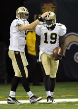 New Orleans Saints quarterback Drew Brees (9) congratulates wide receiver Devery Henderson (19) after Henderson scored on a 79-yard touchdown pass from Brees during the second quarter of an NFL football game against the Chicago Bears at the Louisiana Superdome in New Orleans, Sunday, Sept. 18, 2011. (AP Photo/Bill Feig)