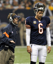 Chicago Bears quarterback Jay Cutler (6) listens to quarterback coach Shane Day during a time out in the first half of an NFL football game against the New Orleans Saints at the Louisiana Superdome in New Orleans, Sunday, Sept. 18, 2011. (AP Photo/Bill Feig)