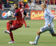 Real Salt Lake forward Alvaro Saborio sends the ball for a fast break against Sporting Kansas City during their1-0 home win in Rio Tinto Stadium. Stephen Holt/ Special to the Tribune