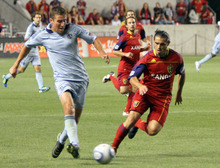 Sporting Kansas City defender Matt Besler keeps the ball from Real Salt Lake forward Fabian Espindola during RSL's 1-0 win in Rio Tinto Stadium. Stephen Holt/ Special to the Tribune