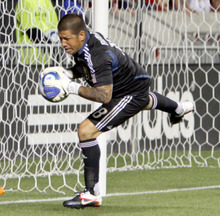 Real Salt Lake goalkeeper Nick Rimando makes a save to keep the lead at 1 against Sporting Kansas City in Rio Tinto Stadium. Stephen Holt/ Special to the Tribune