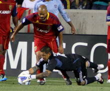 Real Salt Lake goalkeeper Nick Rimando makes a save during the first half against Sporting Kansas City in Rio Tinto Stadium. Stephen Holt/ Special to the Tribune