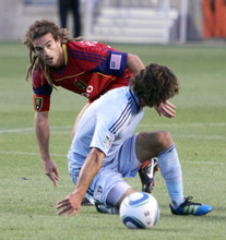 Real Salt Lake midfielder Kyle Beckerman (5) has trouble in the midfield against Sporting Kansas City in Rio Tinto Stadium. Stephen Holt/ Special to the Tribune