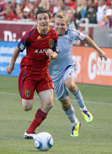 Real Salt Lake midfielder Will Johnson makes a break for it past Sporting Kansas City defender Michael Harrington in the first half at Rio Tinto Stadium. Stephen Holt/ Special to the Tribune