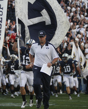 Rick Egan | The Salt Lake Tribune  BYU coach Bronco Mendenhall and his team take the field prior to the start of the Cougars' game agains Utah at Lavell Edwards Stadium in Provo, Utah September 17, 2011.