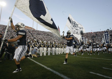 Rick Egan | The Salt Lake Tribune  The BYU Cougars take the field prior to the start of the Cougars' game agains Utah at Lavell Edwards Stadium in Provo, Utah September 17, 2011.
