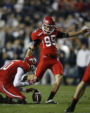 Trent Nelson | The Salt Lake Tribune  Utes wide receiver DeVonte Christopher (10) holds while Utes kicker Coleman Petersen (95) attempts a field goal during BYU's game against Utah at Lavell Edwards Stadium in Provo, Utah September 17, 2011.