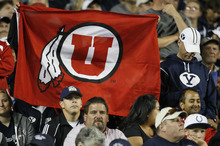 Trent Nelson | The Salt Lake Tribune  A Ute flag flies in the stands among stunned BYU fans as Utah runs away with the game during BYU's game against Utah at Lavell Edwards Stadium in Provo, Utah September 17, 2011.