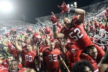 Rick Egan  | The Salt Lake Tribune   The Utes celebrate their 54-10 win over BYU, Saturday, September 17, 2011.