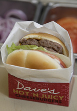 In this Sept. 15, 2011 photo, a new Dave's Hot 'N Juicy Cheeseburger is displayed in the Wendy's research and development laboratory at the company's international headquarters in Dublin, Ohio. (AP Photo/Paul Vernon)