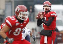 Utah quarterback Jordan Wynn (3) looks to pass against BYU during the first half of an NCAA college football game Saturday, Nov. 27, 2010, in Salt Lake City. (AP Photo/Jim Urquhart)