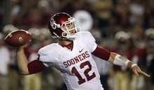 Chris O'Meara  |  The Associated Press Quarterback Landry Jones and top-ranked Oklahoma won't be joining the Pac-12 after the league decided against expansion on Thursday night.