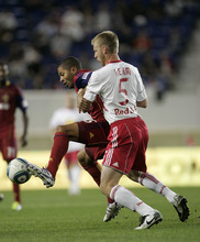 Rich Schultz  |  The Associated Press Real Salt Lake's Alvaro Saborio, left, controls the ball as New York Red Bulls' Tim Ream (5) defends during the first half of an MLS soccer game at Red Bull Arena in Harrison, N.J., Wednesday. Real Salt Lake defeated the Red Bulls 3-1.