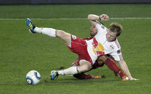 Rich Schultz  |  The Associated Press New York Red Bulls' Dax McCarty, front, and Real Salt Lake's Arturo Alvarez get entangled as they fight for the ball during the second half of an MLS soccer game at Red Bull Arena in Harrison, N.J., Wednesday. Real Salt Lake defeated the Red Bulls 3-1.