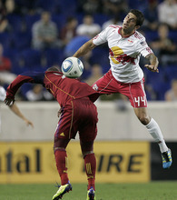 Rich Schultz  |  The Associated Press New York Red Bulls' Carlos Mendes (44) misses the ball on a header as it lands on the back of Real Salt Lake's Andy Williams, left, during the first half of an MLS soccer game at Red Bull Arena in Harrison, N.J., Wednesday. Real Salt Lake defeated the Red Bulls 3-1.