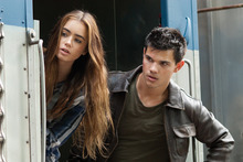 Courtesy photo Taylor Lautner, right, and Lily Collins in