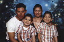 Leonel Medina, shown with his wife, Silvia Alfaro, and two sons, Leonel, 11, and Gaudalupe, 9,  was a victim of an immigration fraud that federal authorities say was committed by James H. Alcala.