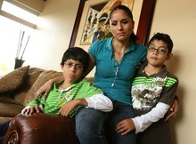 Leah Hogsten  |  The Salt Lake Tribune Silvia Alfaro and her two sons Leonel Median, 11, left, and Guadalupe Medina, 9, at their West Valley home Aug. 18. In 2009, Silvia Alfaro's husband, Leonel Medina, was deported to Mexico. His lawyer, James H. Alcala, has been accused of defrauding undocumented immigrants and conspiracy against the United States. Alcala is now a fugitive.