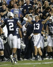 Trent Nelson  |  The Salt Lake Tribune BYU quarterback Riley Nelson (13) celebrates a kick return touchdown by Cody Hoffman (2). BYU vs. Central Florida, college football at LaVell Edwards Stadium in Provo, Utah, Friday, September 23, 2011.