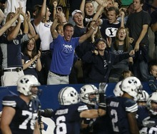 Trent Nelson  |  The Salt Lake Tribune BYU fans celebrate a third quarter touchdown by JJ Di Luigi. BYU vs. Central Florida, college football at LaVell Edwards Stadium in Provo, Utah, Friday, September 23, 2011.