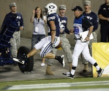 Trent Nelson  |  The Salt Lake Tribune BYU's JJ Di Luigi high-steps into the end zone for a touchdown. BYU vs. Central Florida, college football at LaVell Edwards Stadium in Provo, Utah, Friday, September 23, 2011.