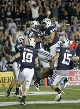 Trent Nelson  |  The Salt Lake Tribune BYU players celebrate Cody Hoffman's touchdown run on a kick return in the third quarter. BYU vs. Central Florida, college football at LaVell Edwards Stadium in Provo, Utah, Friday, September 23, 2011.