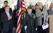 Francisco Kjolseth  |  The Salt Lake Tribune  Veteran Lonnie Cutler, of the VFW 1695 in Brigham City, carries the U.S. flag while presenting the colors for a groundbreaking of veterans' housing on Tuesday. The Veterans Affairs Salt Lake City Health Care System and the Salt Lake City Housing Authority broke ground on Valor House, a transitional housing facility for homeless veterans that will be built behind the VA hospital, near Sunnyside Park.