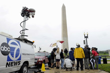 News crews listen to a news conference on the damage to the Washington Monument in Washington, Wednesday, Sept. 28, 2011. Structural engineers are preparing to rappel down the Washington Monument to check on damage caused by last month's earthquake. (AP Photo/Susan Walsh)