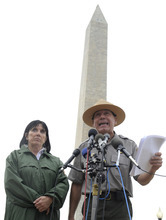 Bill Line of the National Park Service, right, accompanied by Carol Johnson, spokeswoman with the National Mall and Memorial Parks, speaks during a news conference on the Washington Monument in Washington, Wednesday, Sept. 28, 2011. Structural engineers are preparing to rappel down the Washington Monument to check on damage caused by last month's earthquake. (AP Photo/Susan Walsh)