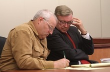Rick Egan  | The Salt Lake Tribune   Chuck Cox, left, makes notes for his attorney, Steve Downing (right), during a custody hearing at the Pierce County Superior Courthouse in Tacoma, Wash., on Tuesday.